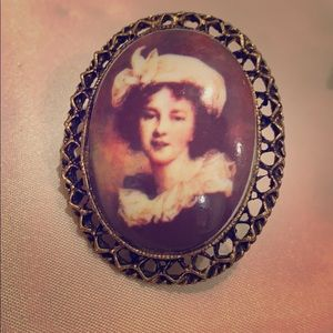 Vintage cameo picture of girl brooch